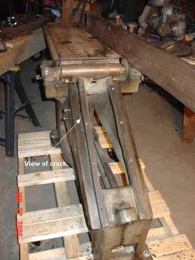 View of crack in jointer sled stay.
