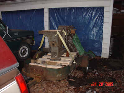 Jointer on trailer in driveway.